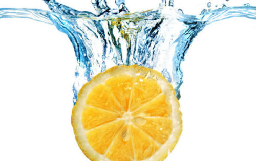 refreshing splashed lemon slice